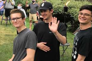 Pandemic precautions weren't as stringent over the summer when Will, left, Ross, center, and Ben all made it home to celebrate their mom's birthday.