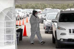 The parking lot at Arlington Park has served as one of the major COVID-19 testing sites in the region. State health officials Thursday reported more than 10.2 million tests have been processed since the onset of the pandemic.
