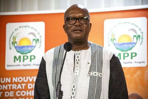 President Roch Marc Christian Kabore addresses supporters in Ouagadougou after learning he will serve another five years as Burkina Faso's president, according to provisional results announced by the National Independent Electoral Commission Thursday Nov 26, 2020.