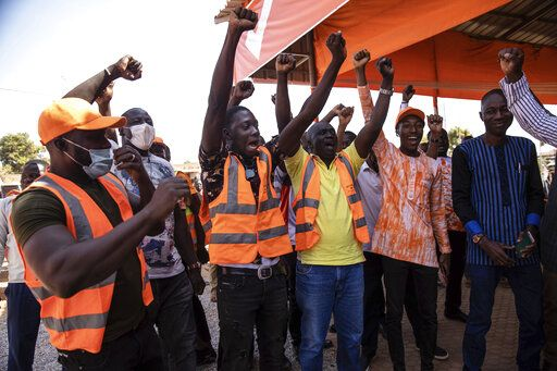 Supporters of President Roch Marc Christian Kabore celebrate in Ouagadougou as they learn he will serve another five years as Burkina Faso's president, according to provisional results announced by the National Independent Electoral Commission Thursday Nov 26, 2020.