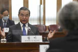 Chinese Foreign Minister Wang Yi, left, talks with South Korean Foreign Minister Kang Kyung-wha, right, during their meeting at the foreign ministry in Seoul, South Korea, Thursday, Nov. 26, 2020. Wang arrived in Seoul on Nov. 25, for a three-day state visit.(Kim Min-hee/Pool Photo via AP)