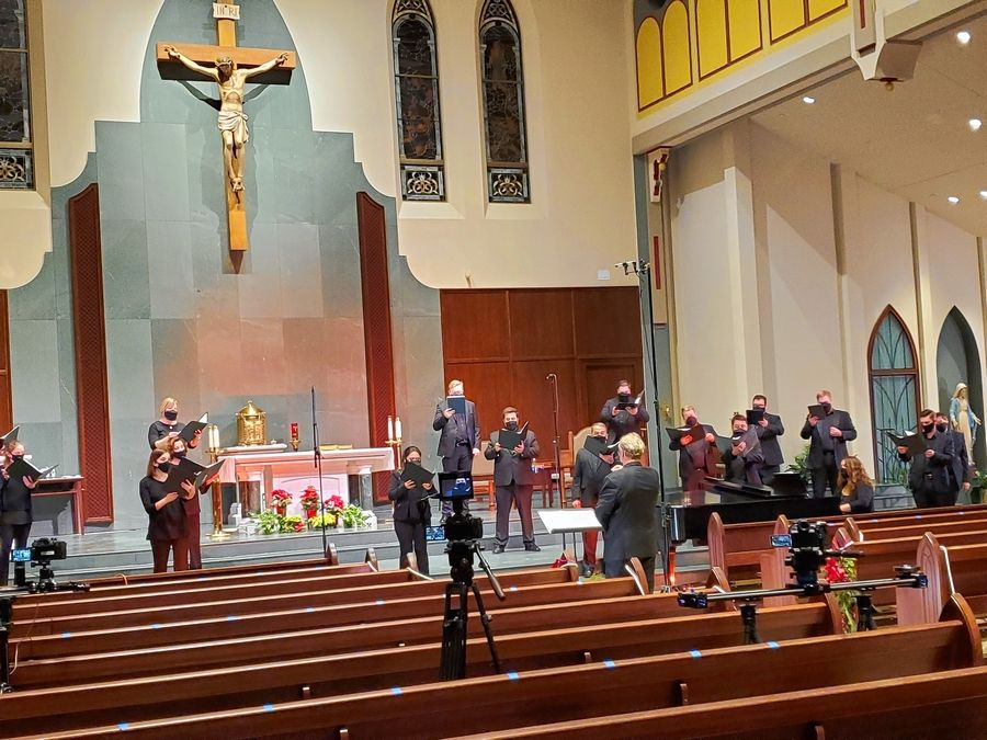 "Jeffrey Hunt conducts the St. Charles Singers during their ""Candlelight Carols"" video recording session at St. Michael Catholic Church in Wheaton. The concert will stream as a free webcast on Sunday, Dec. 6."