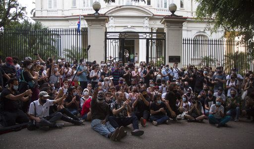 Young artists protest in front of the doors of the Ministry of Culture, in Havana, Cuba, Friday, Nov. 27, 2020. Dozens of Cuban artists demonstrated against the police evicting a group who participated in a hunger strike.