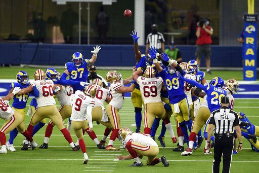 San Francisco 49ers kicker Robbie Gould (9) kicks the game-winning field goal as time expires during the second half of an NFL football game against the Los Angeles Rams Sunday, Nov. 29, 2020, in Inglewood, Calif. San Francisco won 23-20.