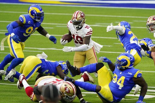 San Francisco 49ers wide receiver Deebo Samuel (19) carries against the Los Angeles Rams during the first half of an NFL football game Sunday, Nov. 29, 2020, in Inglewood, Calif.