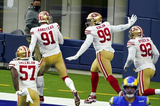 San Francisco 49ers defensive tackle Javon Kinlaw (99) celebrates in the end zone after returning an interception for a touchdown during the second half of an NFL football game Sunday, Nov. 29, 2020, in Inglewood, Calif.