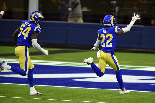 Los Angeles Rams cornerback Troy Hill (22) runs back with a recovered fumble for a touchdown during the second half of an NFL football game against the San Francisco 49ers Sunday, Nov. 29, 2020, in Inglewood, Calif.