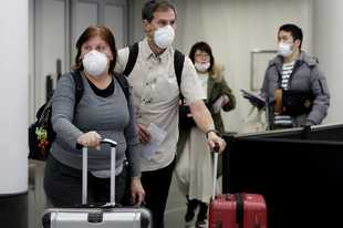 Much like the outset of the pandemic, Illinois public health officials worry about the effects of travelers pouring through Chicago's airports after the long Thanksgiving weekend.