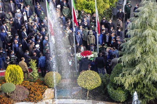 "In this photo released by the official website of the Iranian Defense Ministry, officials and armed forces commanders pray and pay their respect over the flag draped coffin of Mohsen Fakhrizadeh, a scientist who was killed on Friday, in a funeral ceremony in Tehran, Iran, Monday, Nov. 30, 2020. Iran held the funeral service Monday for the slain scientist who founded its military nuclear program two decades ago, with the Islamic Republic's defense minister vowing to continue the man's work ""with more speed and more power."" (Iranian Defense Ministry via AP)"