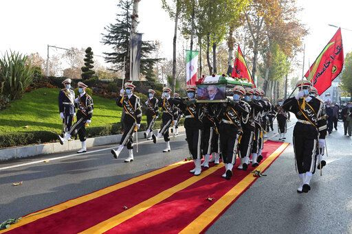 "In this photo released by the official website of the Iranian Defense Ministry, military personnel carry the flag draped coffin of Mohsen Fakhrizadeh, a scientist who was killed on Friday, in a funeral ceremony in Tehran, Iran, Monday, Nov. 30, 2020. Iran held the funeral Monday for the slain scientist who founded its military nuclear program two decades ago, with the Islamic Republic's defense minister vowing to continue the man's work ""with more speed and more power."" (Iranian Defense Ministry via AP)"