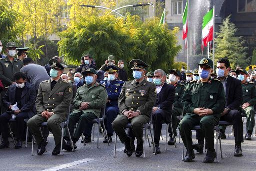 "In this photo released by the official website of the Iranian Defense Ministry, military military commanders attend a funeral ceremony of Mohsen Fakhrizadeh, a scientist who was killed on Friday, in a funeral ceremony in Tehran, Iran, Monday, Nov. 30, 2020. Iran held the funeral Monday for the slain scientist who founded its military nuclear program two decades ago, with the Islamic Republic's defense minister vowing to continue the man's work ""with more speed and more power."" (Iranian Defense Ministry via AP)"
