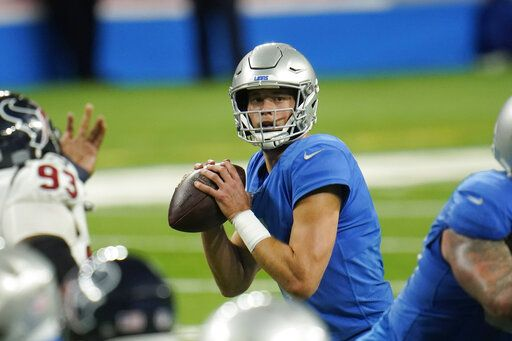 Detroit Lions quarterback Matthew Stafford looks downfield during the second half of an NFL football game, against the Houston Texans Thursday, Nov. 26, 2020, in Detroit.