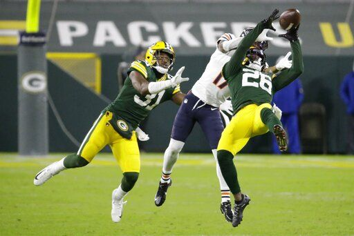 Green Bay Packers' Darnell Savage intercepts a pass in front of Chicago Bears' Anthony Miller during the second half of an NFL football game Sunday, Nov. 29, 2020, in Green Bay, Wis.