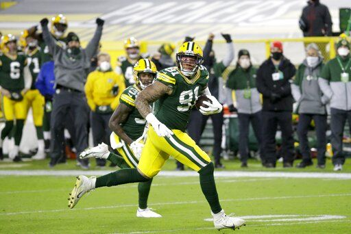 Green Bay Packers' Preston Smith runs for a touchdown on a fumble recovery during the first half of an NFL football game against the Chicago Bears Sunday, Nov. 29, 2020, in Green Bay, Wis.