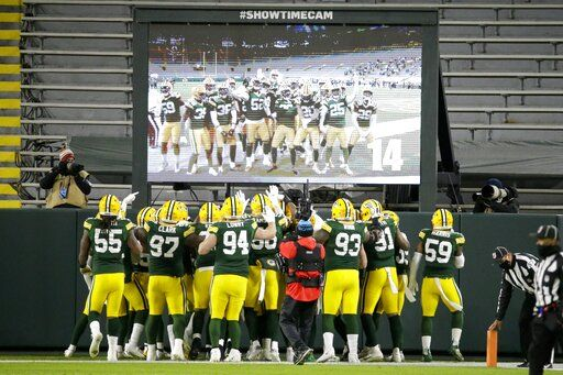 Green Bay Packers players help Darnell Savage celebrate his interception in the end zone during the first half of an NFL football game against the Chicago Bears Sunday, Nov. 29, 2020, in Green Bay, Wis.