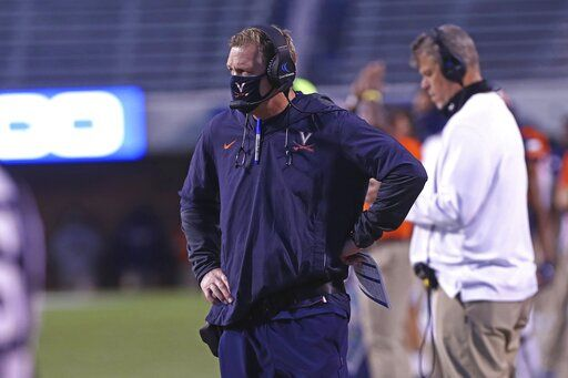 Virginia head coach Bronco Mendenhall  looks on during an NCAA college football game against Abilene Christian, Saturday, Nov. 21, 2020, in Charlottesville, Va. (Erin Edgerton/The Daily Progress via AP)