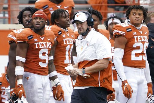 FILE - In this Friday, Nov. 27, 2020, file photo, Texas head coach Tom Herman, center, walks on the sideline during the second half of an NCAA college football game against Iowa State in Austin, Texas. Herman batted away questions about his future with the program on Monday, Nov. 30, 2020, and insisted on trying to keep the focus on the Longhorns' players trying to win their last two games of the season.