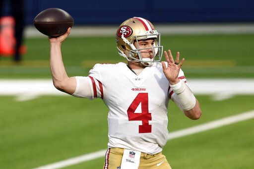 San Francisco 49ers quarterback Nick Mullens throws against the Los Angeles Rams during the first half of an NFL football game Sunday, Nov. 29, 2020, in Inglewood, Calif.