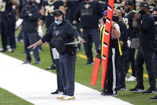 FILE - In this Sunday, Nov. 22, 2020 file photo, New Orleans Saints head coach Sean Payton reacts on the sideline in the first half of an NFL football game against the Atlanta Falcons in New Orleans. The NFL has fined the New Orleans Saints $500,000 and stripped them of a 2021 seventh-round draft pick for violating league COVID-19 protocols, a person with direct knowledge of the discipline told The Associated Press on Sunday, Nov. 29. New Orleans was fined as a repeat offender; Payton previously was docked $150,000 and the team $250,000 because the head coach failed to properly wear a face covering against the Raiders in Week 2.