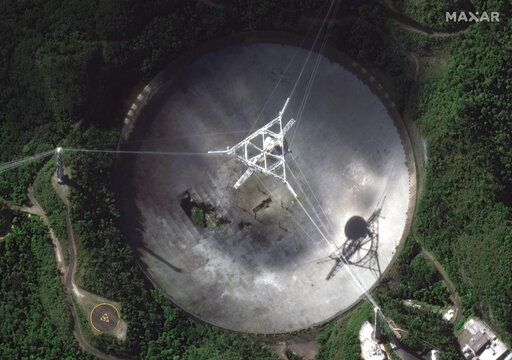 This satellite image provided by 2020 Maxar Technologies shows the damaged radio telescope at the Arecibo Observatory in Puerto Rico, Thursday, Nov. 17, 2020. The National Science Foundation announced Thursday, Nov. 17 that it will close the huge telescope in a blow to scientists worldwide who depend on it to search for planets, asteroids and extraterrestrial life, saying it's too dangerous to keep operating the single-dish radio telescope because the entire structure could collapse. (Satellite image ©2020 Maxar Technologies via AP)