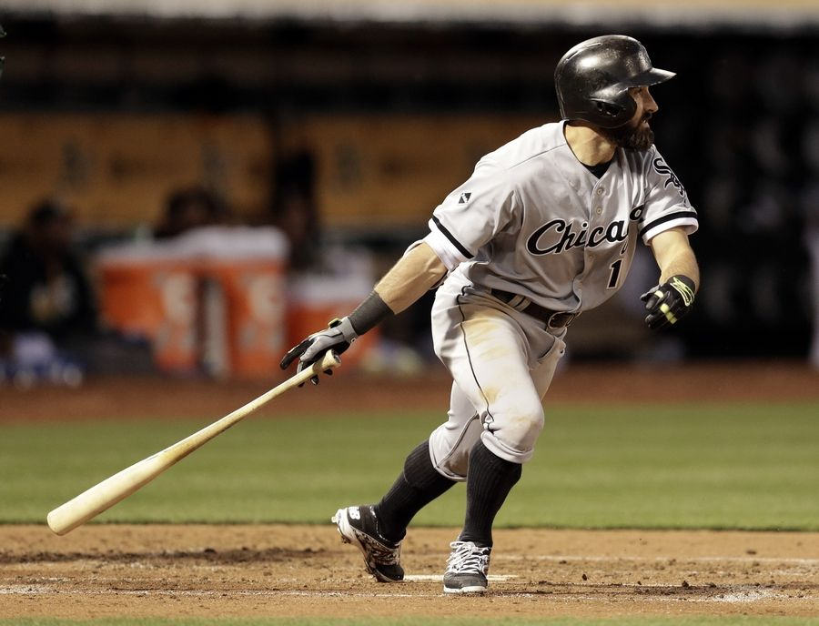 Chicago White Sox's Adam Eaton hits a triple against the Oakland Athletics in Oakland, California.
