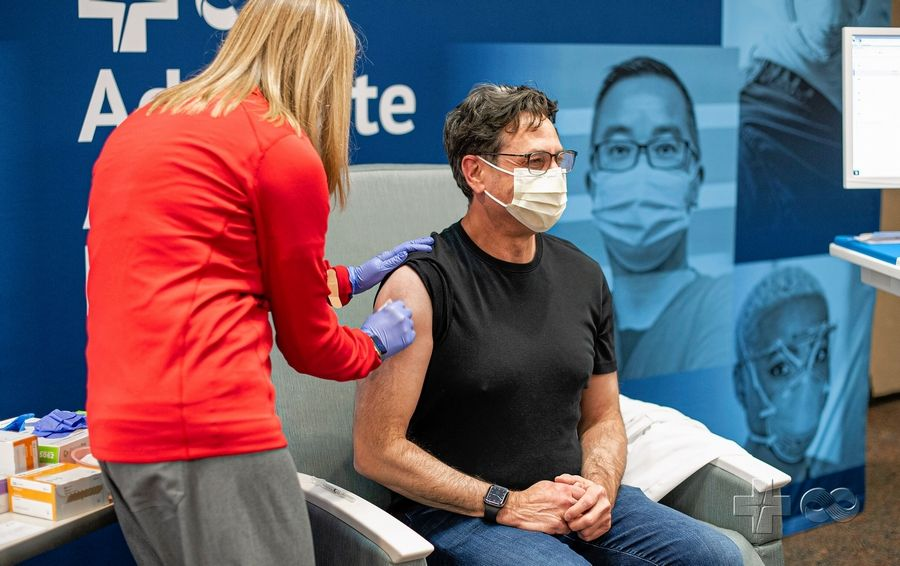 Niles-based Infectious Disease Specialist Dr. Robert Citronberg received his first dose of the coronavirus vaccine from a nurse at Advocate Good Samaritan Hospital in Downers Grove on Thursday.