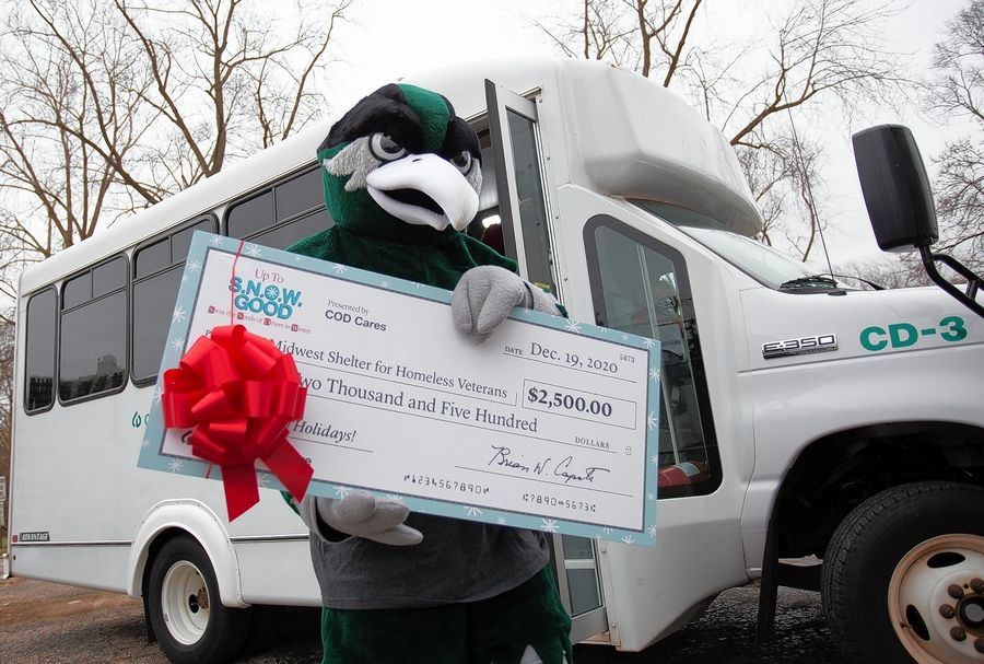 Chaparral, the College of DuPage mascot, delivers donation checks from COD Cares in support of Bridge Communities, Midwest Shelter for Homeless Veterans Services, DuPage Pads, Family Shelter Services and COD's Fuel Pantry.