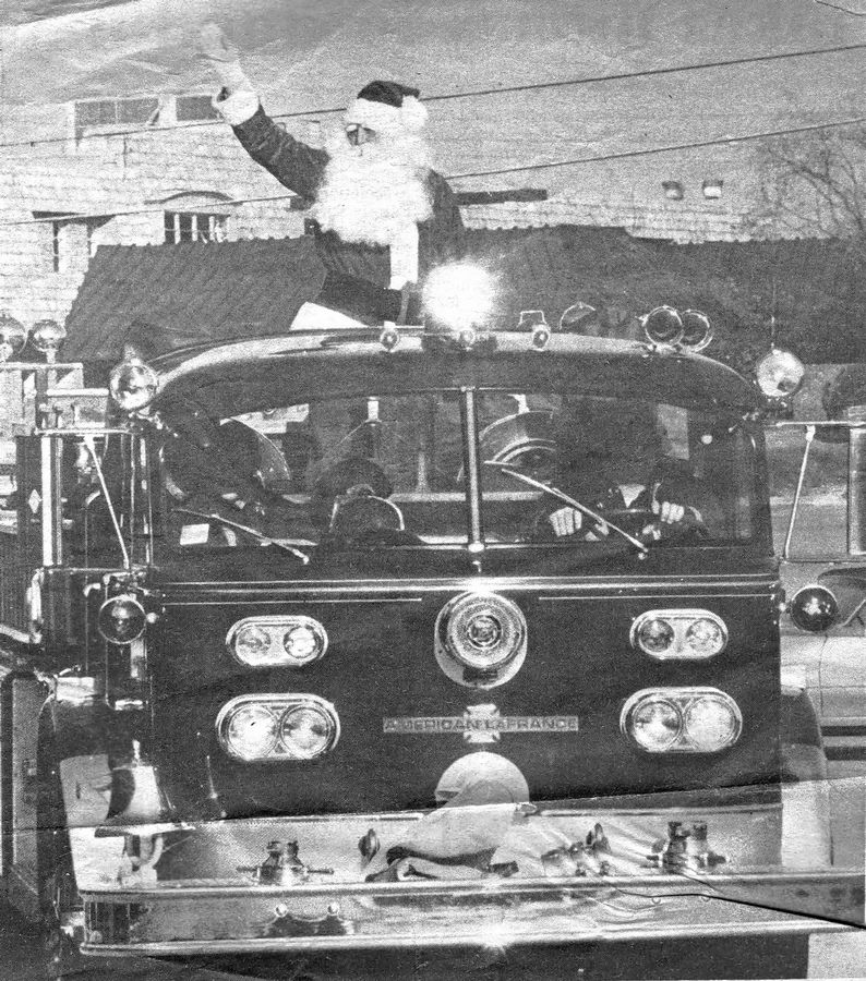 While the arrival of Santa Claus in downtown Northbrook often was celebrated with a variety of festivities from the mid-1950s into the early 1980s, Santa also often visited other nearby shopping areas. Here he tours the perimeter of Deerbrook Mall in style aboard a Northbrook fire truck in 1972.