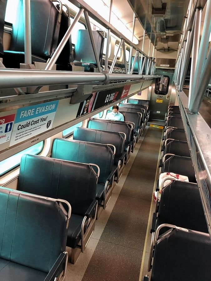 Warnings remind Metra riders on the BNSF Line to physically distance during train trips. The commuter railroad has seen ridership drop because of COVID-19.