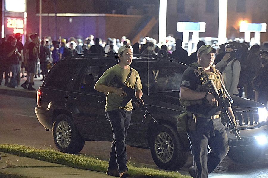 Antioch teen Kyle Rittenhouse, left, with backward cap, seen here on Aug. 25, 2020 during civil unrest in Kenosha, Wisconsin.