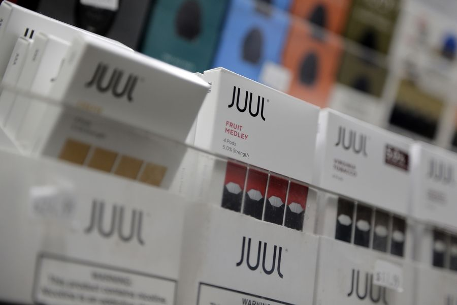 The Maine Township High School District 207 board on Monday hired a law firm to sue e-cigarette manufacturer Juul Labs.