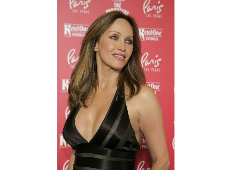 "Actress Tanya Roberts poses for photos at the grand opening of the musical comedy ""The Producers"" at the Paris hotel-casino in Las Vegas. Roberts, who captivated James Bond in ""A View to a Kill"" and appeared in the sitcom ""That '70s Show,"" died Monday, several hours after she was mistakenly declared dead by her publicist and her partner. Roberts' partner, Lance O'Brien, confirmed her death Tuesday after picking up her personal effects at a Los Angeles hospital. She was 65."