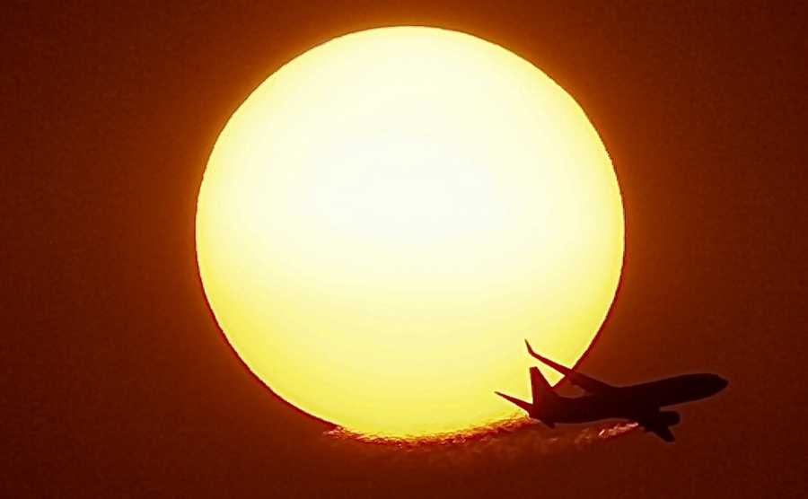 October: Due to the smoke from the Western wildfires, I was able to shoot directly into the sun with my camera as the sun was going down. Timing is everything, and from the haze you can see the vapors from the plane's engines.