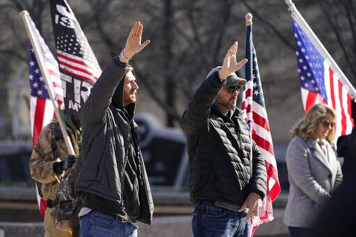 People take part in a rally at the Legislative Plaza, Wednesday, Jan. 6, 2021, in Nashville, Tenn. Two Tennessee lawmakers organized a prayer rally on Wednesday timed to coincide with a protest in the nation's Capitol in support of President Donald Trump's baseless claims that he won reelection.