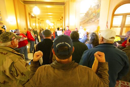 Supporters of President Donald Trump gather inside the Kansas Statehouse, Wednesday, Jan. 6, 2021, in Topeka, Kan., after rain moved the rally inside. (Evert Nelson/The Topeka Capital-Journal via AP)
