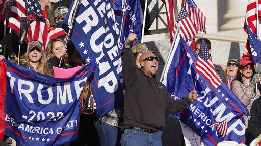 Supporters of President Donald Trump attend a rally in protest of President-elect Joe Biden election win, Wednesday, Jan. 6, 2021, in Salt Lake City.