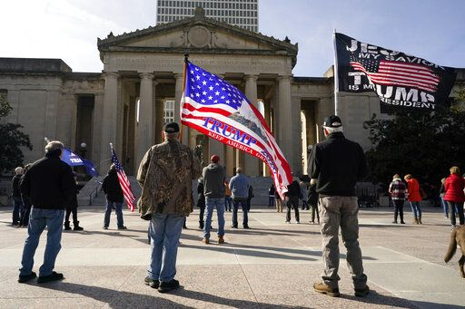 People take part in a rally at the Legislative Plaza, Wednesday, Jan. 6, 2021, in Nashville, Tenn. Two Tennessee lawmakers organized a prayer rally timed to coincide with a protest in the nation's Capitol in support of President Donald Trump's baseless claims that he won reelection.