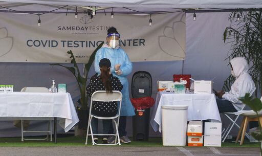 A mid-turbinate nasal swab PCR test is administered at a same-day coronavirus testing site in Los Angeles on Tuesday, Jan. 5, 2021. Los Angeles is the epicenter of California's surge that is expected to get worse in coming weeks when another spike is expected after people traveled or gathered for Christmas and New Year's.