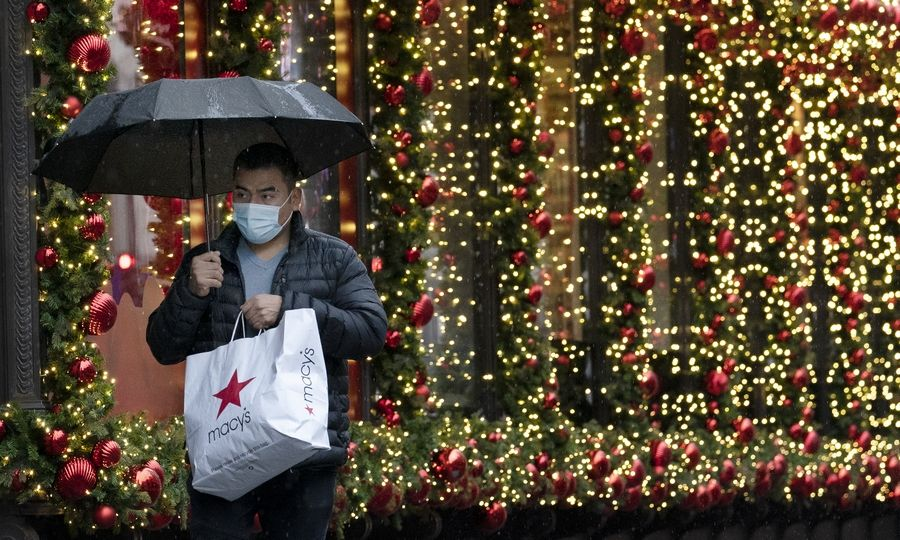 A shopper walks by a holiday window display last November in New York.