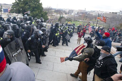 U.S. Capitol Police push back demonstrators who were trying to enter the U.S. Capitol on Wednesday, Jan. 6, 2021, in Washington.