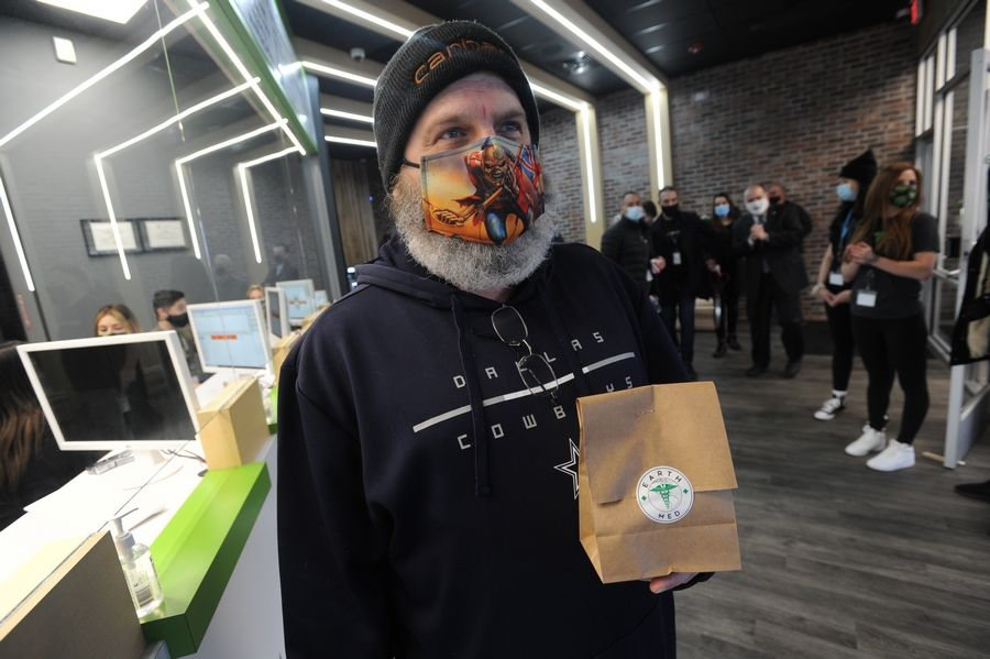 "Bob Reed of Huntley was an early customer at the EarthMed marijuana dispensary after its opening Monday in Rosemont. ""I love it,"" he said. ""This particular store is all recreational, where some are both recreational and medical. This being just recreational, you are in and out quicker."""
