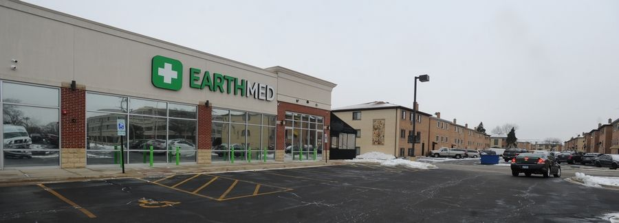 The EarthMed recreational marijuana dispensary opened Monday morning on Touhy Avenue in Rosemont. It's in a strip mall next to a set of apartment buildings and just north of the Allstate Arena.