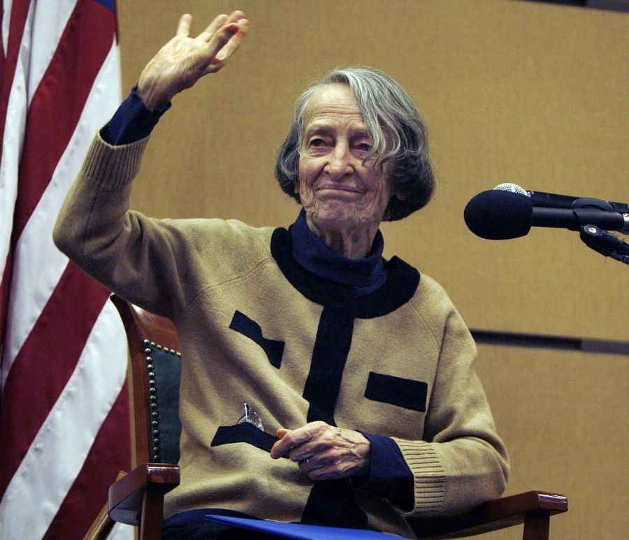 After speaking at the Arlington Heights Mayor's 25th Annual Community Prayer Breakfast in 2012, writer and activist Margery Frisbie acknowledges a standing ovation.