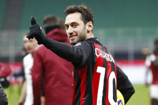 AC Milan's Hakan Calhanoglu celebrates after his team defeated Torino in the Italian Cup round of 16 soccer match between AC Milan and Torino at the San Siro stadium, in Milan, Italy, Tuesday, Jan. 12, 2021.
