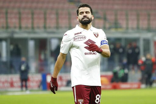 Torino's Tomas Rincon reacts after failing to score from a penalty shot during the Italian Cup round of 16 soccer match between AC Milan and Torino at the San Siro stadium, in Milan, Italy, Tuesday, Jan. 12, 2021.