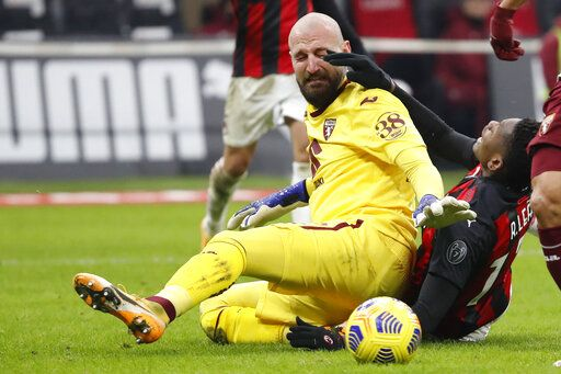 Torino's goalkeeper Vanja Milinkovic-Savic fights for the ball with AC Milan's Rafael Leao, right, during the Italian Cup round of 16 soccer match between AC Milan and Torino at the San Siro stadium, in Milan, Italy, Tuesday, Jan. 12, 2021.
