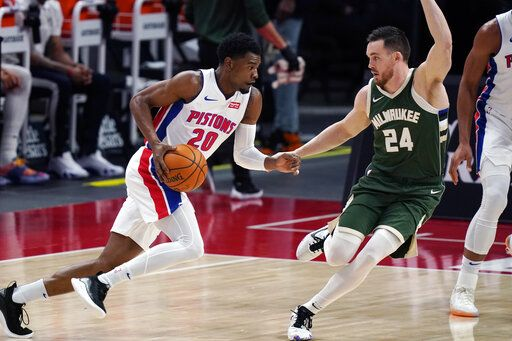 Detroit Pistons guard Josh Jackson (20) drives on Milwaukee Bucks guard Pat Connaughton (24) during the first half of an NBA basketball game, Wednesday, Jan. 13, 2021, in Detroit.