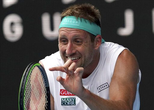 FILE - In this Jan. 28, 2020, file photo, Tennys Sandgren of the U.S. reacts after losing a point to Switzerland's Roger Federer during their quarterfinal match at the Australian Open tennis championship in Melbourne, Australia. Sandgren has reportedly been allowed on an Australia-bound flight despite recently testing positive for coronavirus.