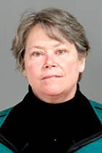 This photo provided by the Genesee County Sheriff's Office in Flint, Mich., shows Eden Wells, the former Michigan Chief Medical Officer, who was charged with nine felony counts involuntary manslaughter, and two felony counts misconduct in office on Thursday, Jan. 14, 2021, in connection with the Flint water crisis in Flint, Mich. (Genesee County Sheriff's Office via AP)