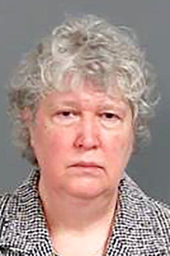 This photo provided by the Genesee County Sheriff's Office in Flint, Mich., shows Nancy Peeler, the former Michigan Early Childhood Health Section manager, who was charged with two felony counts misconduct in office and misdemeanor willful neglect of duty Thursday, Jan. 14, 2021 in connection with the Flint water crisis in Flint, Mich. (Genesee County Sheriff's Office via AP)